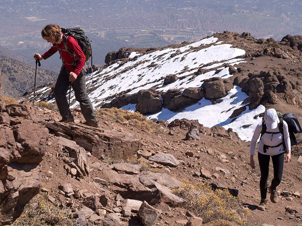 Ascending to the summit along the rocky ridge, the steepest and hardest part of the climb.