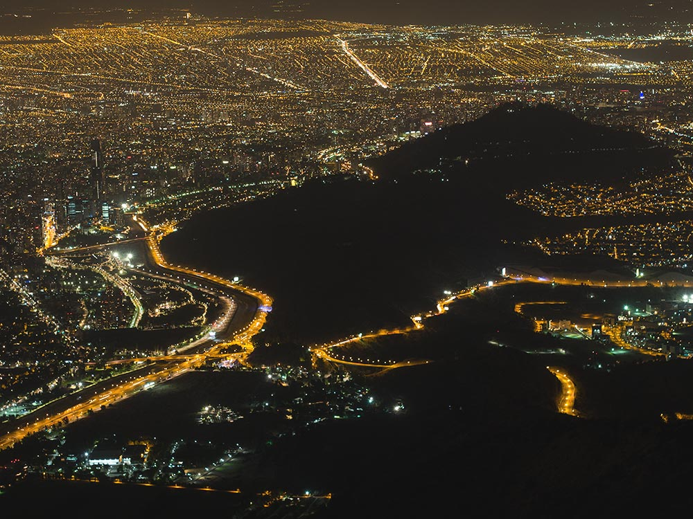 Santiago city and San Cristobal night view from Manquehue mountain - Trekking Santiago Chile