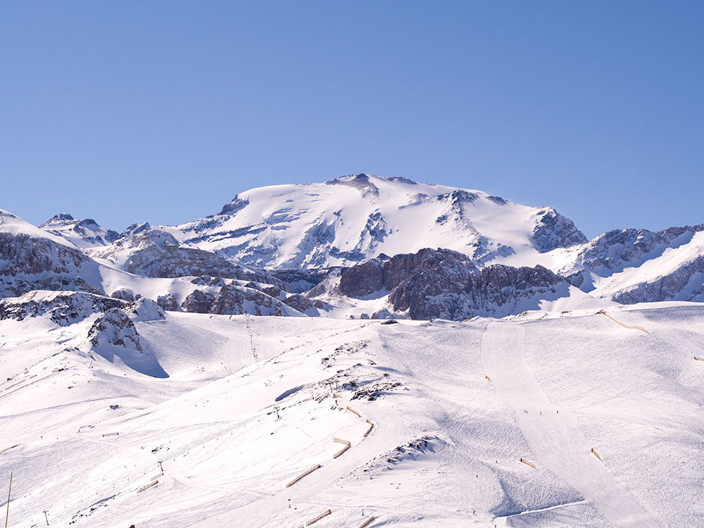 Winter view of La Parva Center ski slopes and mount El Plomo, the highest peak visible from Santiago with and elevation of 5,434m (17,783ft).